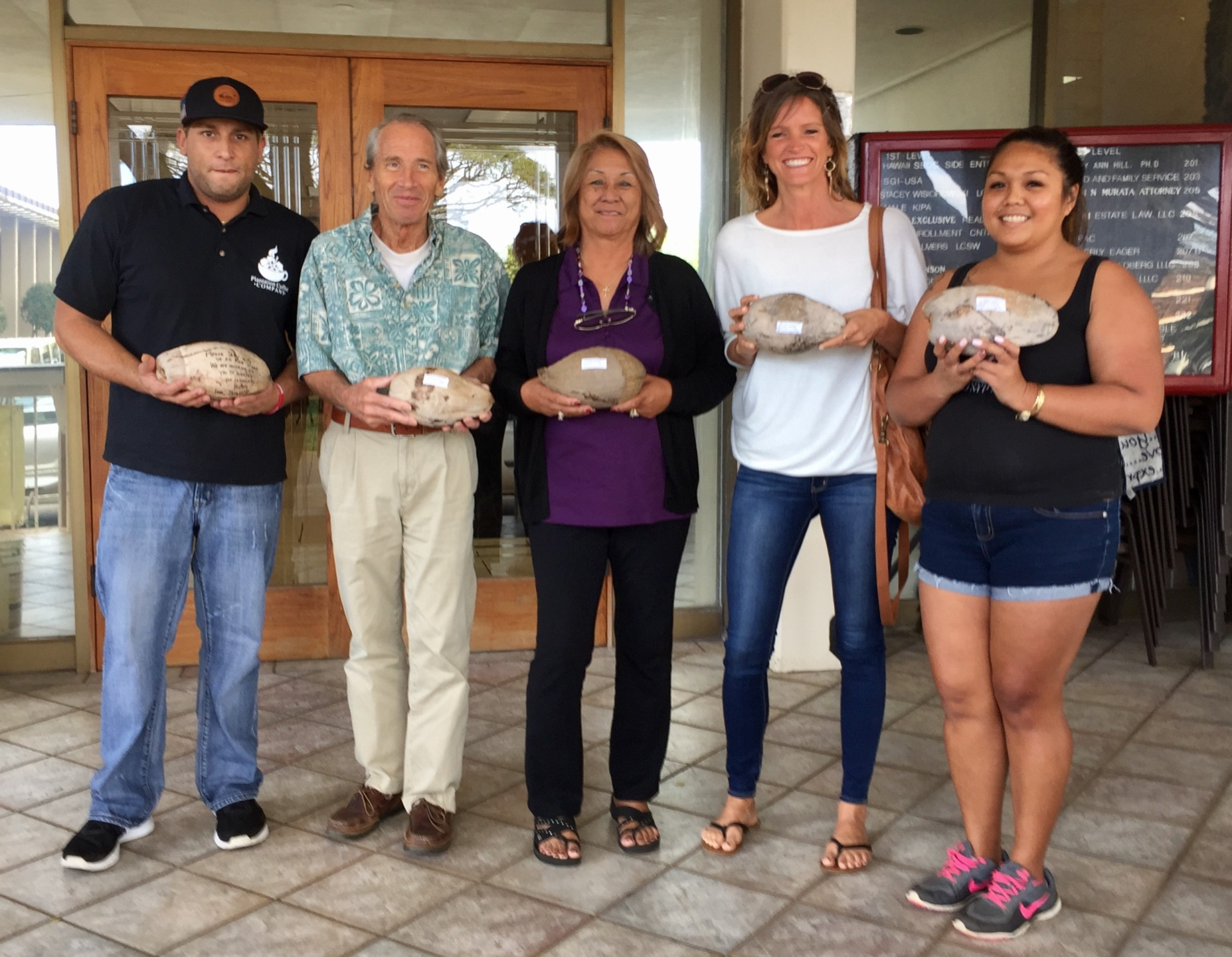 Lihue residents mailing coconuts to the USPS in support of keeping historic Lihue Post Office open.